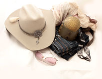 Stetson and accessories. Stetson, boots and jeans on a white background Stock Photos