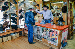 Stetson Hat Fitting. Cowboy purchasing a Stetson hat and getting it reshaped Royalty Free Stock Photography