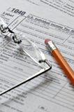 Steuer-Verpflichtungen Stockfoto