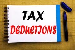 Steuerabzüge Geschäftskonzept für Finanzden ankommenden Steuer-Geld-Abzug geschrieben auf Notizblockbriefpapierhintergrund mit Ra Lizenzfreies Stockfoto