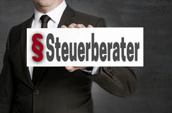 Steuerberater in german Tax adviser plate is held by businessm. An Royalty Free Stock Images
