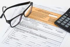 Steuererklärungsgrube Stockbild
