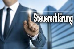 Steuererklaerung (in German Tax Declaration) Touchscreen Is Operated By Businessman Stock Photography
