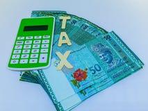 Steuerfinanzkonzept Steuerkonzept bargeld Finanzplan lizenzfreie stockfotos