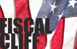 Steuerliche Klippenwörter auf USA-Flagge Stockbild