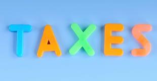 Steuern in den bunten Magneten Lizenzfreies Stockfoto
