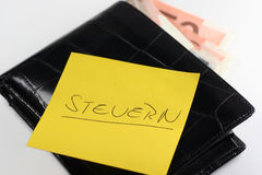 Steuern - wallet. Wallet with reminder Steuern (german word for Tax) and euro notes Stock Photography