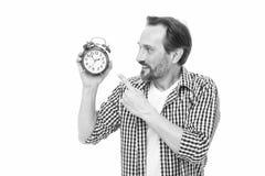 Steuerung und Disziplin Griffwecker der zuf?lligen Art des Mannes Zeitmanagement und Aufschub Kontrollieren Sie Zeit stockfoto