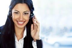 Steunexploitant met hoofdtelefoon en het glimlachen Stock Foto