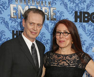 """Steve Buscemi and Jo Andres. Film and television actor Steve Buscemi and wife Jo Andres arrive on the red carpet for the """"Boardwalk Empire TV Series Season 3 New Royalty Free Stock Photos"""