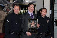 Steve Guttenberg. With LAPD Officers  at 's Star on the Hollywood Walk of Fame Ceremony, Hollywood, CA 12-12-11 Stock Images