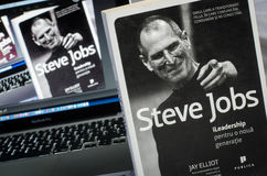 Steve Jobs Biography book. BUCHAREST, ROMANIA - DECEMBER 29, 2014: Steve Jobs Biography book near the macbook pro Royalty Free Stock Photos