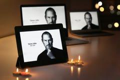STEVE JOBS displays on Apple products. Riyadh Saudi Arabia - September 28, 2012: An iPad displays Steve Jobs, alongside candles, offer a simple goodbye to the Royalty Free Stock Image