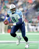 Steve McNair. Quarterback Steve McNair of the Tennessee Titans rolls out the pocket for the a open receiver. The Tennessee Titans went on to defeat the Royalty Free Stock Photos