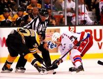 Steve Miller NHL Linesman. Linesman Steve Miller (89) drops the puck between Boston Bruins Patrice Bergeron and Washington Capitals Jay Beagle (83 Stock Image