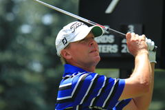 Steve Stricker. Watches his shot after he swings his driver Royalty Free Stock Photo