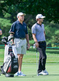 Steve Williams caddying for Adam Scott. Royalty Free Stock Photography