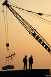 Stevedore. 2 stevedores are standing on a truck royalty free stock images