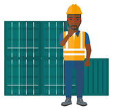 Stevedore standing on cargo containers background. Stock Photography
