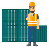 Stevedore standing on cargo containers background Stock Photos