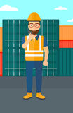 Stevedore standing on cargo containers background. Stock Photos