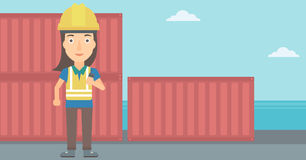 Stevedore standing on cargo containers background. Stock Photo