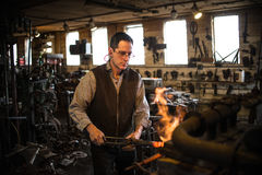 Steven Bronstein Blacksmith forges owl beak Royalty Free Stock Photos