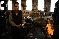 Steven Bronstein Blacksmith forges owl beak Stock Images