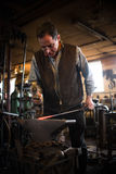 Steven Bronstein Blacksmith forges owl beak Royalty Free Stock Photography