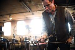 Steven Bronstein Blacksmith forges owl beak Royalty Free Stock Photo