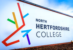 STEVENAGE,UK- NOVEMBER 11, 2016 Name of North Hertfordshire College on the wall Royalty Free Stock Images