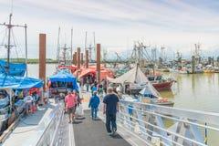Fisherman`s Wharf in Steveston Village, Richmond, BC, Canada. STEVESTON, BRITISH COLUMBIA/ CANADA - JUNE 2017: tourists and locals visit the famous fish market Stock Photos