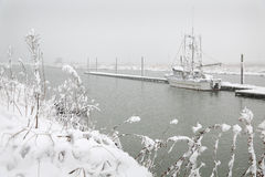 Steveston Dock Winter Snow. A lone fishboat tied to the dock waiting out a winter snowstorm. Steveston, British Columbia, Canada Royalty Free Stock Image