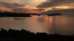 Steveston Harbor Sunrise 4K. UHD. A boat departs Steveston Harbor on the Fraser River in British Columbia, Canada at sunrise. 4K. UHD stock footage