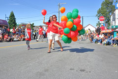 Steveston Salmon Festival and Canada Day Parade. Volunteers hand out balloons during the Steveston Salmon Festival Canada Day Parade in Steveston, British Stock Photography