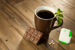 Stevia chocolate and coffee. Cup of coffee with stevia sweetener tablets and Belgian chocolate without sugar Royalty Free Stock Photos