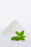 Stevia with a pile of sugar vertical Stock Photo