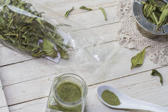 Stevia. Still life with dried stevia leaves in a plastic bag, glass bottle with stevia powder and sieve for infusion Royalty Free Stock Image