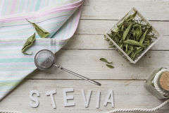 Stevia. Still life with dried stevia leaves, sieve and cloth napkin, ready for making an infusion Royalty Free Stock Photo