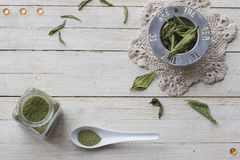 Stevia. Still life with dried stevia leaves on a sieve for making an infusion, glass bottle with stevia powder and white spoon Royalty Free Stock Images