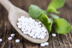 Stevia sweetener pills. (selective focus) on wooden background Stock Photography