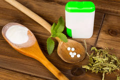 Stevia tabs and powder. Zero-carb sweetener stevia as powder, tabs and dried leaves Stock Photos