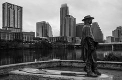 Stevie Ray Statue Austin Skyline Background Stock Photo