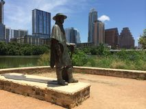 Stevie Ray Vaughan Statue with Austin Texas in Background stock image