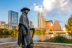 Stevie Ray Vaughan statue in front of downtown Austin and the Co Stock Photography