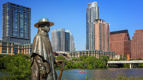 Stevie Ray Vaughan Statue in Front of Downtown Austin, Texas and Royalty Free Stock Images