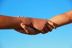 Stevig gehouden handen stock afbeelding
