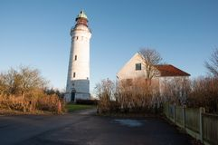 Stevns Lighthouse in Denmark. At Stevns Lighthouse, you are at the highest point along Stevns Klint which is a Unesco world heritage area in Denmark Stock Images