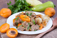 Stew with apricots. In a plate Royalty Free Stock Image