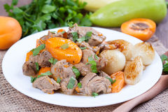Stew with apricots. In a plate Royalty Free Stock Photo